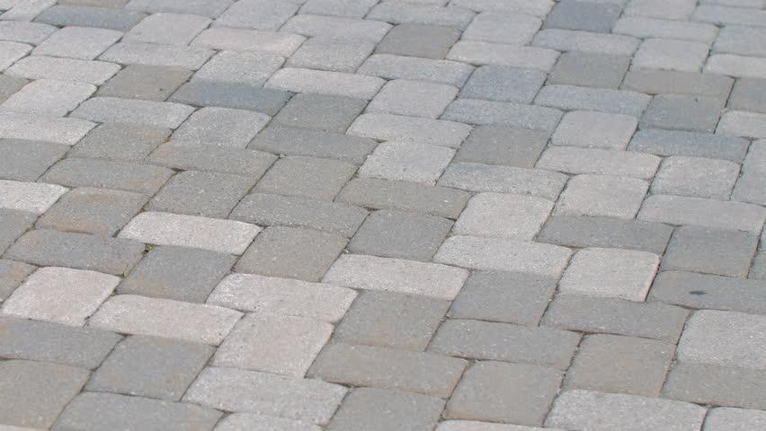 Grey brick walkway medium shot pan abstract