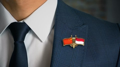 Businessman Walking Towards Camera With Friend Country Flags Pin China - Monaco