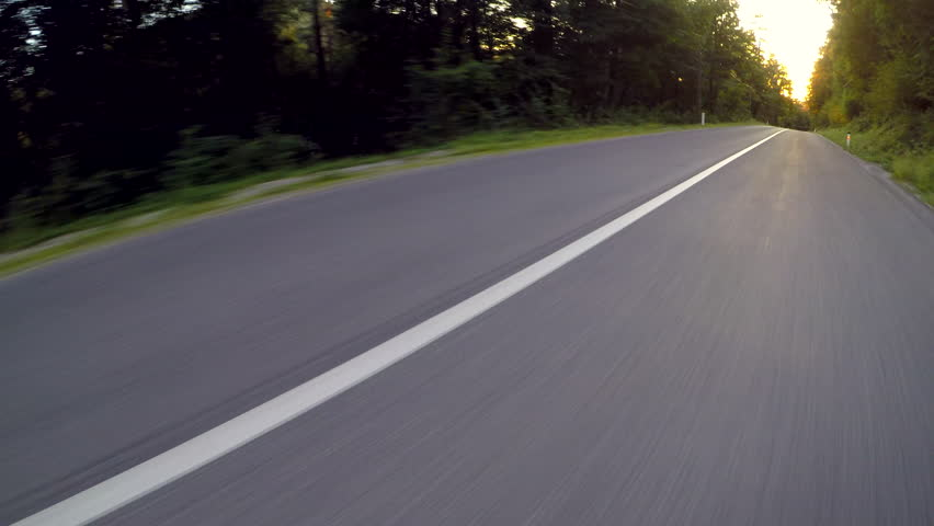 Driving car at sunset. Point of view video