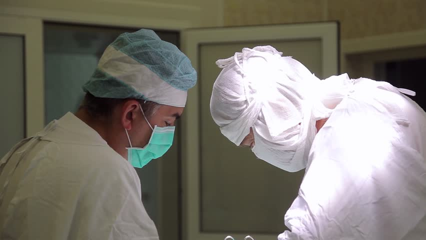 Two surgeons conduct an oncological operation using the newest medical surgical instruments | Shutterstock HD Video #1015332496
