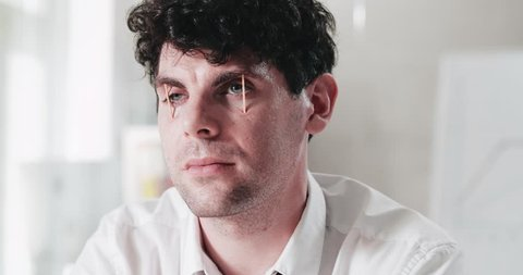 Close-up of extremely tired man putting matches into his eyes preventing himself from falling asleep at workplace.