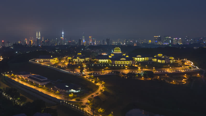 Time lapse: Dramatic night aerial view of the Kuala Lumpur skyline with the national palace in the foreground. Motion timelapse zoom out. Prores Full HD 1080p. 4K available. | Shutterstock HD Video #1015350376