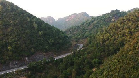 Road in Mountains and forest in Cat Ba Island, Ha long Bay, Vietnam - Drone footage
