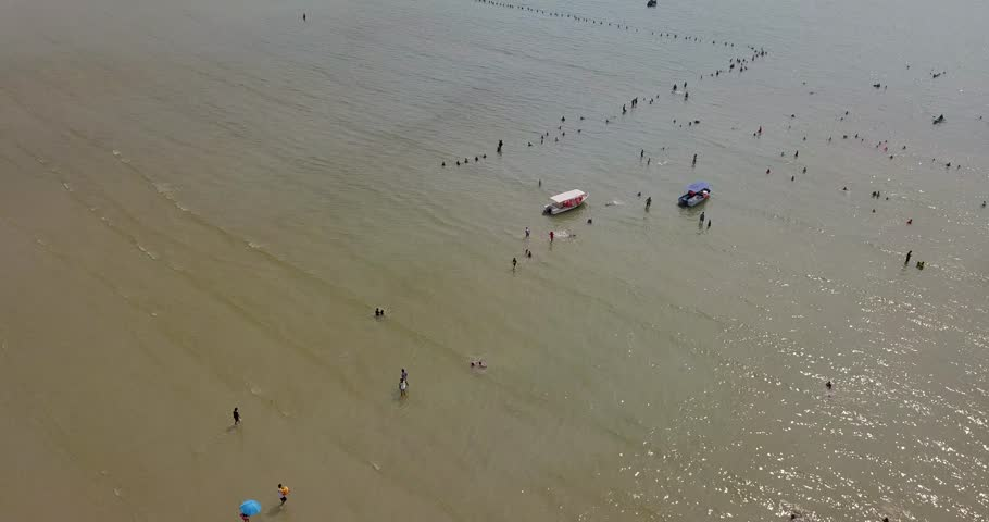 Aerial view with people walking on sea beach background  | Shutterstock HD Video #1015382986