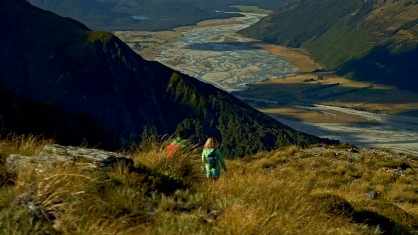 Aerial drone of young Caucasian adventure travellers hiking nature in Mt Aspiring National Park South Island New Zealand | Shutterstock HD Video #1015397566