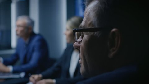 Portrait of the Senior Member of the Board Of the Directors Listening to His Business Partners on a Meeting. Shot on RED EPIC-W 8K Helium Cinema Camera.