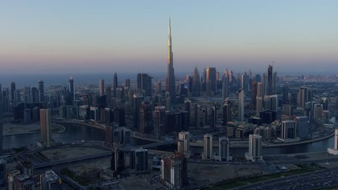 Aerial sunset city view Dubai Creek Downtown Business Bay commercial area modern vehicle transport highway United Arab Emirates Middle East Dubai RED WEAPON
