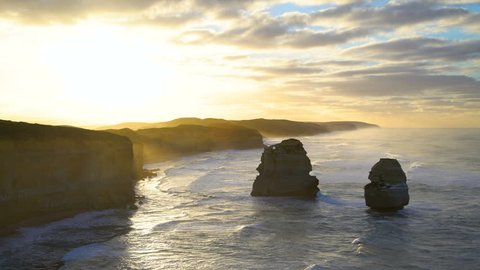 Twelve Apostles Marine National Park offshore rock stacks and limestone cliffs scenic ocean view at dawn Victoria Australia