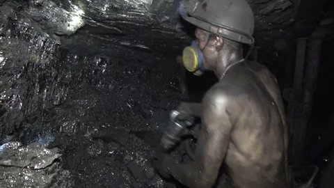 The man produces coal miner using a jackhammer