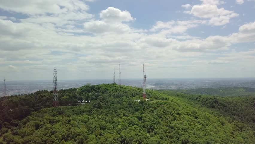 Communication transmitter towers on a hill aerial footage   Shutterstock HD Video #1015501366