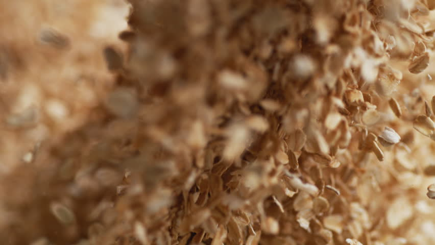 Throwing dried oats. Shot with high speed camera, 4K. Slow Motion. | Shutterstock HD Video #1015533046