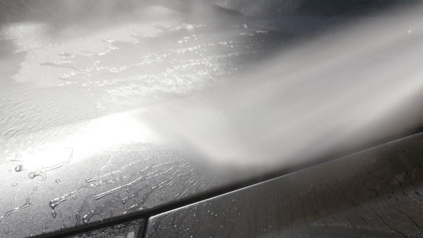 Gray color hood washing with automatic car pressure washer close-up video