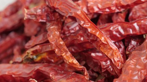 Pile of air-dried chilli peppers 4K slow pan video