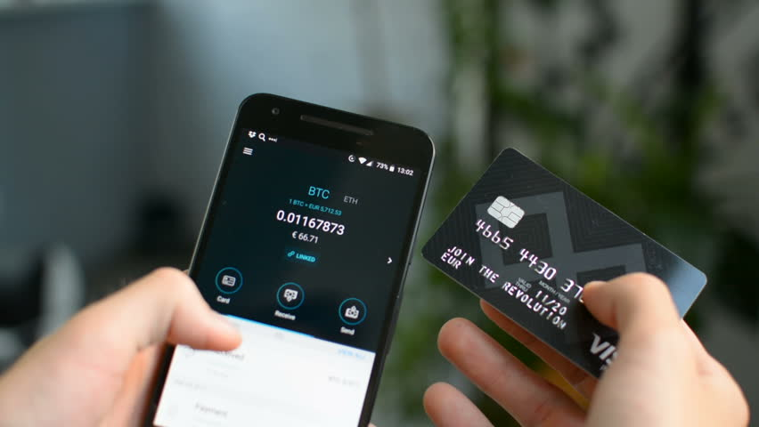 August 2018: Bitcoin payment EUR credit card and mobile phone with Bitcoin wallet | Shutterstock HD Video #1015635226