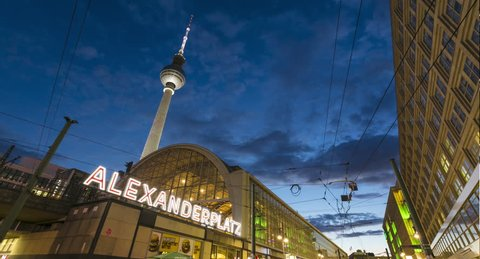 Alexanderplatz, Berlin, Germany - 20th August 2018: Day to night timelapse with light trails - wide shot