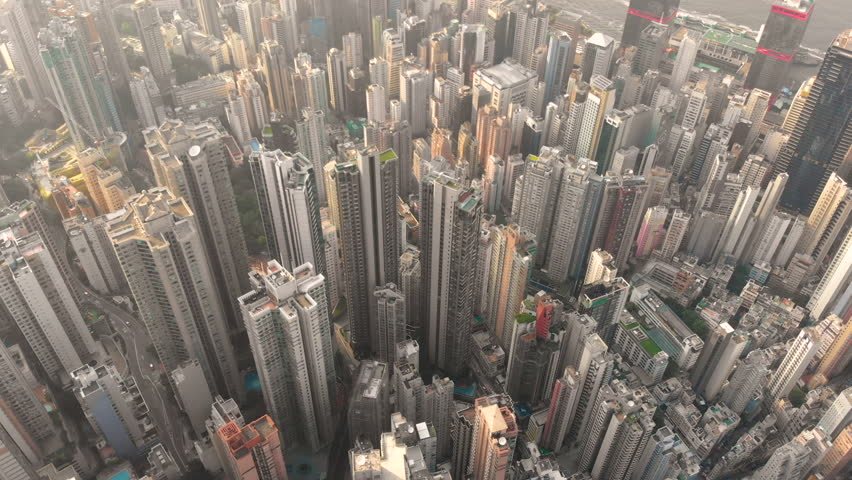 Aerial drone shot of Hong Kong city reveal residential area and office building | Shutterstock HD Video #1015702516