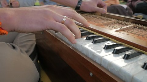 Close Shot Of Playing Harmonium A Musical Instrument. Traditional India Musical Instruments Harmonium