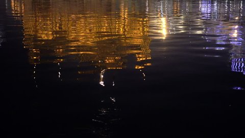 Video of the Golden Temple at sunset reflected in the waters of the lake in Amritsar, Punjab, India. Harmandir Sahib is the holiest pilgrim site for the Sikhs.