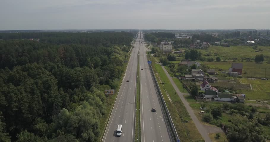 Arial view cars moving on highway on background field. 4k 4096 x 2160 pixels