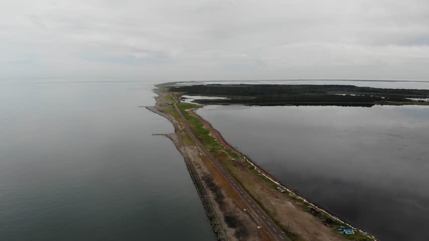 Aerial view of narrow spit and road in the sea, Notsuke Peninsula, Hokkaido, Japan