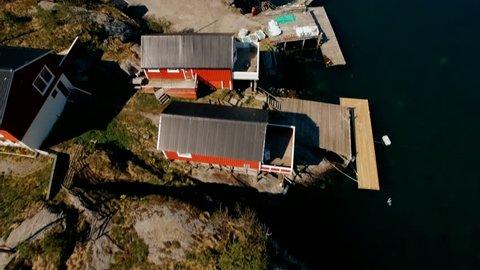 Flying Over Reine On The Lofoten Islands, Norway. The Typical Norwegian Fishing Village Of Reine - Tilt Up