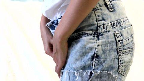 Woman dresses denim shorts. She like wears denim shorts