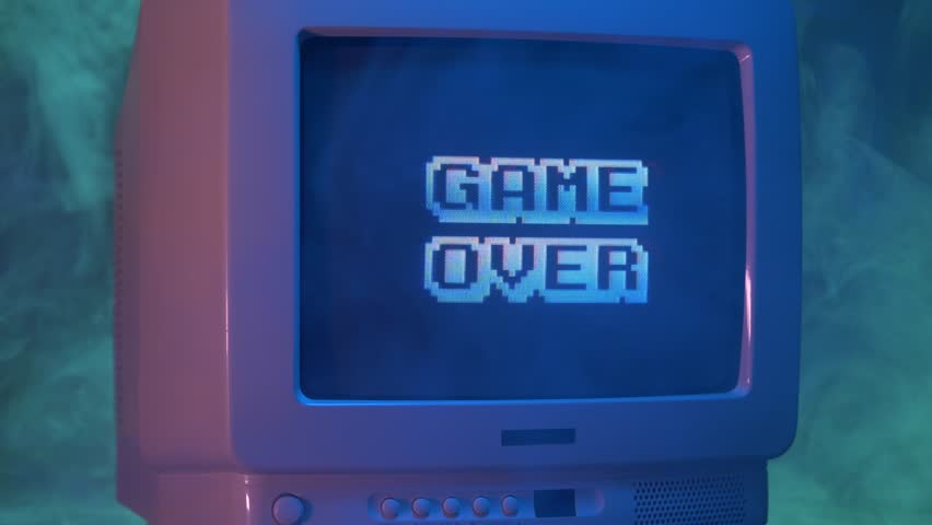 GAME OVER title on a tube TV Vintage 80's 90's arcade.Zooming out with fog giving a retro look at the scene. | Shutterstock HD Video #1015901956