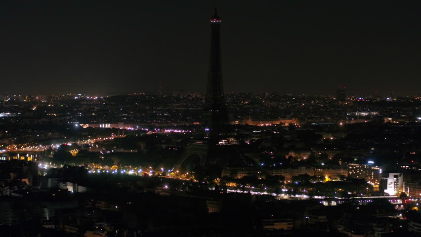 Aerial video of the Eiffel Tower at night with a zoom lens in Paris France. Eiffel Tower with no lights at night. | Shutterstock HD Video #1015903486