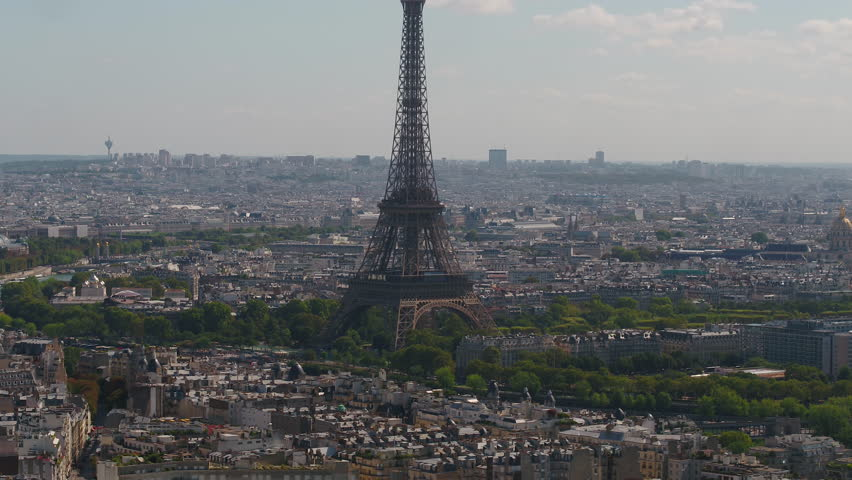 Aerial video of the Eiffel Tower on a sunny day with a zoom lens in Paris France. | Shutterstock HD Video #1015903606