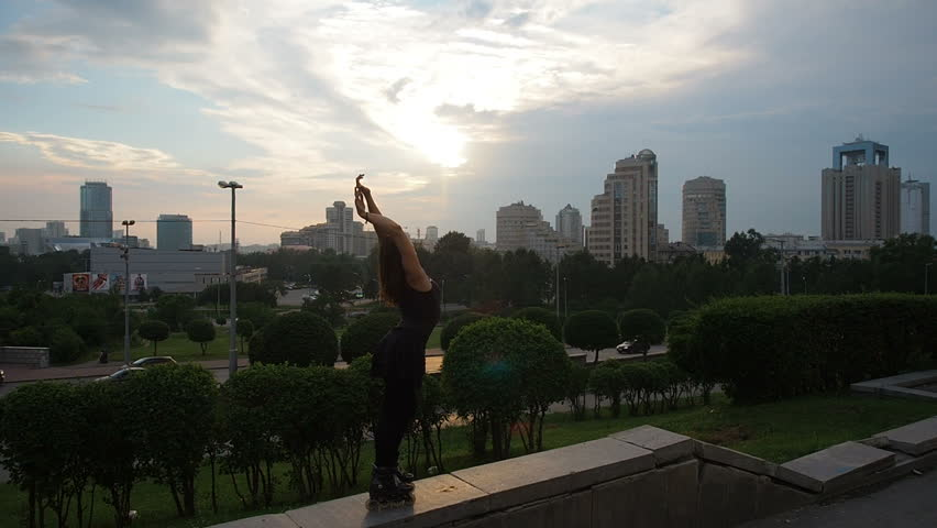 Young Beautiful Woman Riding On Roller Skates City Streets Summer Sunset. Active Lifestyle Roller Skating City.  #1015926196