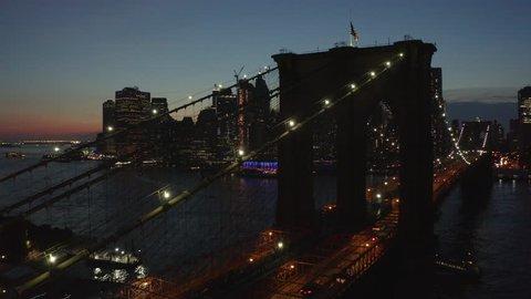 night flying along Brooklyn Bridge towards downtown Manhattan view