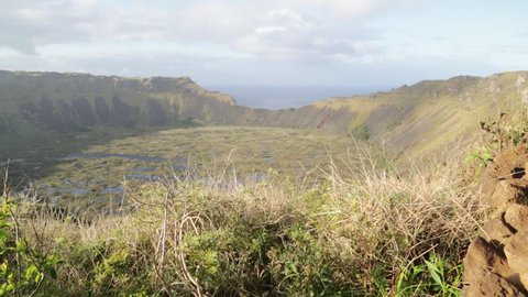 in chile rapa nui the antique and mysteriuos volcano and lake near ocean nature and park