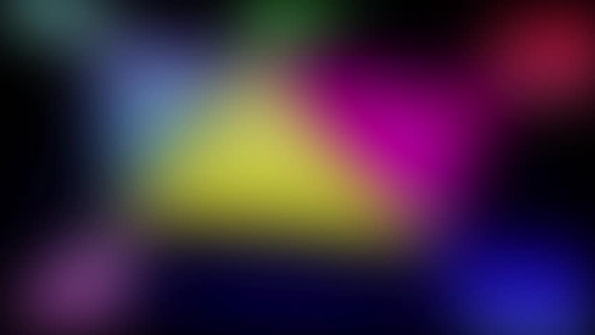 Blurred spots of changing colors and light on dark background. 10 seconds loop | Shutterstock HD Video #1015992166