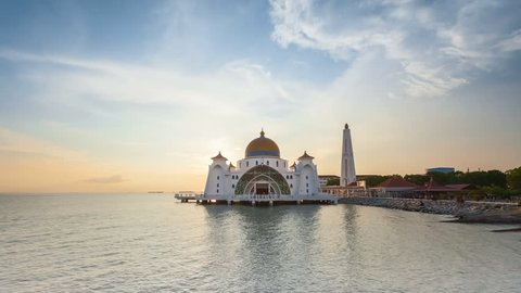 Dramatic Time lapse of sunset and scattered clouds at a mosque in Melaka, Malaysia. Day to night. Zoom in motion timelapse. Prores Full HD 1080p.