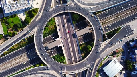 Aerial drone hyperlapse video of urban elevated toll road junction and interchange overpass ring road and Attiki odos of Attica, Athens, Greece