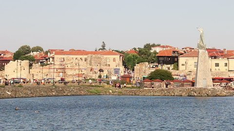 Saint Nicholas monument and old town Nessebar cityscape Bulgaria