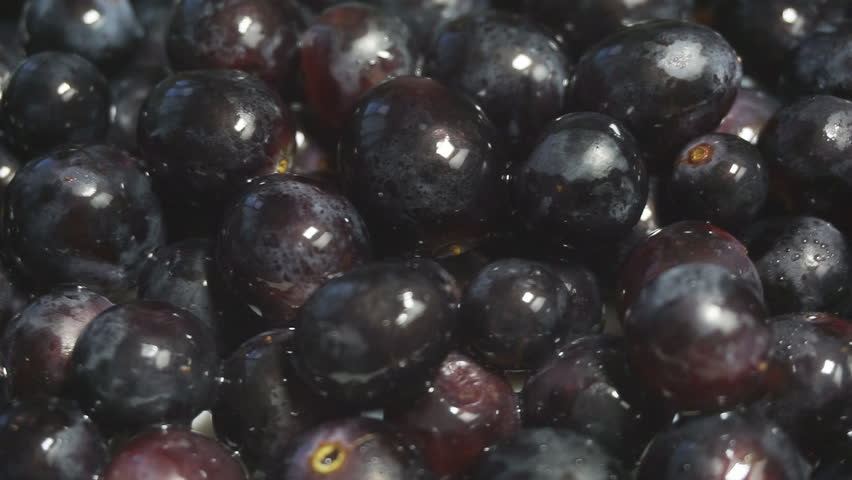 Black grapes rotation background. Grape close up. Slow motion