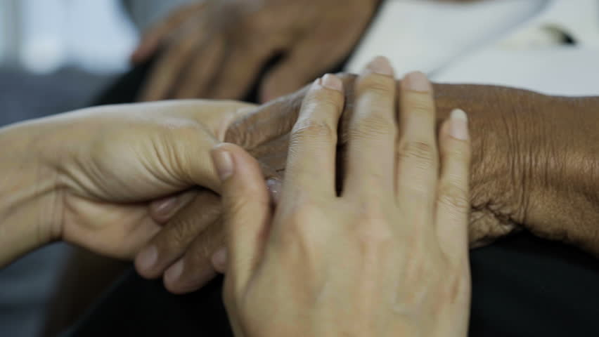 Senior and young holding hands | Shutterstock HD Video #1016142136