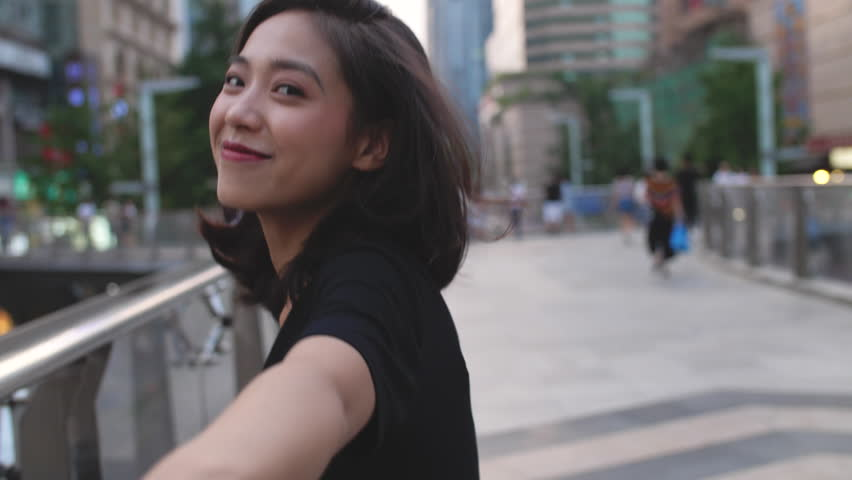 One lovely young asian girl smile at camera while running in the city street, slow motion | Shutterstock HD Video #1016188846