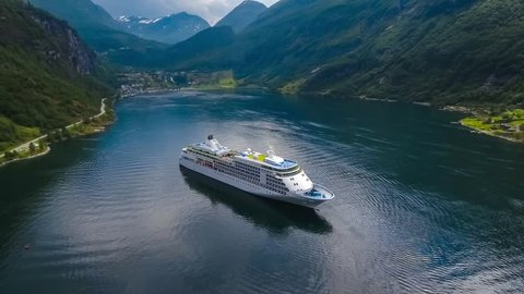 Cruise Ship, Cruise Liners On Geiranger fjord, Norway. It is a 15-kilometre (9.3 mi) long branch off of the Sunnylvsfjorden, which is a branch off of the Storfjorden (Great Fjord).
