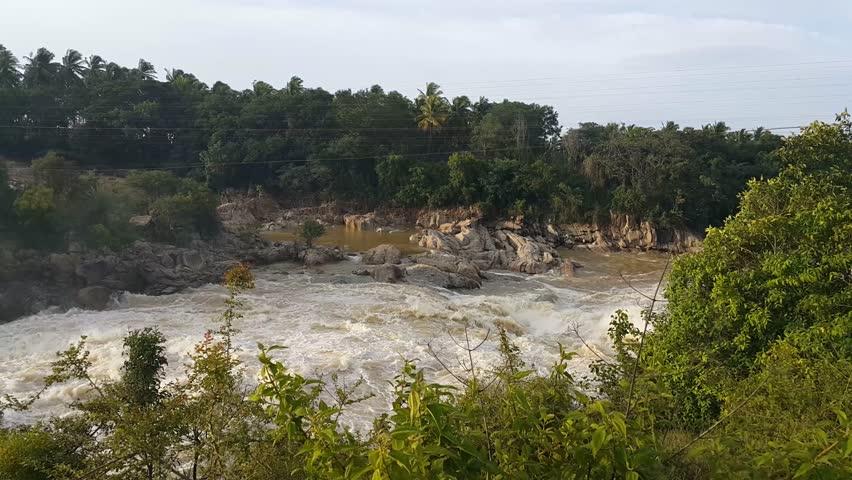 View of Krishna Raja Sagara Dam  flood water out flow through gates - A Historic dam on river cauvery in  Mysore, India on Aug 24-2018