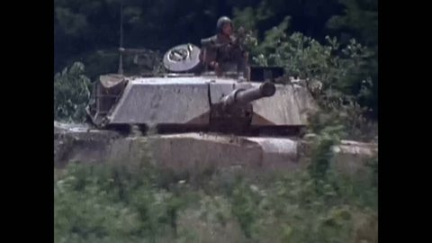 CIRCA 1980S - An M1 Abrams battle tank is destroyed by a BGM-71 TOW anti-tank missile fired from a Bradley Fighting Vehicle.