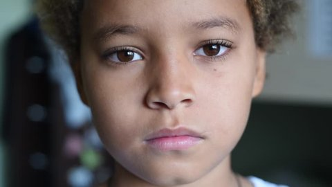 Cute mixed boy face. African american handsome boy sad  face. Close up portrait.