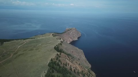 Lake Baikal. Olkhon island. Aerial survey. Scenic lake snow field mountain in summer. Sunny day Expanse landscape shamanism mysterious ritual innocent. Hoboy cape.