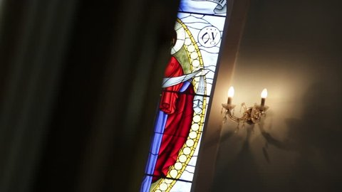 Stained glass in the church. Mother of God.