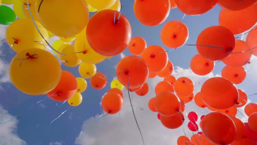 Variety colorfull baloons in the scky with clouds and sun