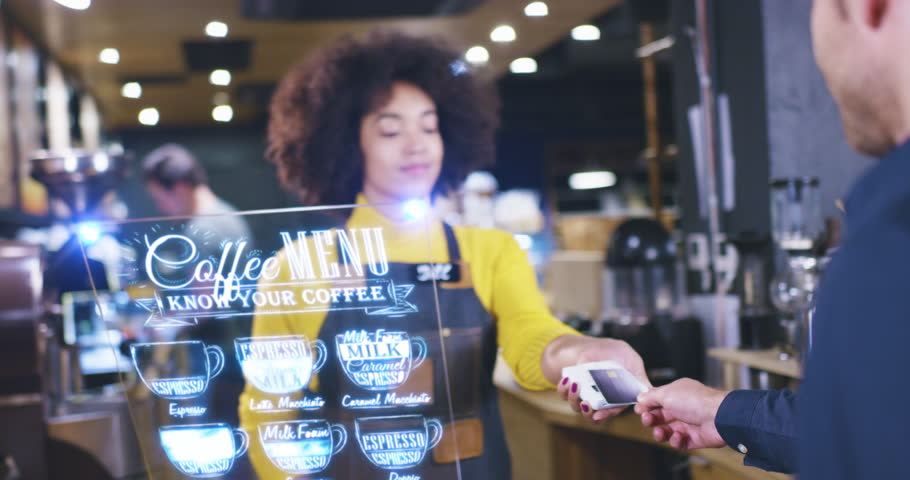 Beautiful Barista Woman Servicing Client At Cafe Bar Futuristic Hud Display Menu Wireless Payment Near Future Concept Red Epic 8K | Shutterstock HD Video #1016321476