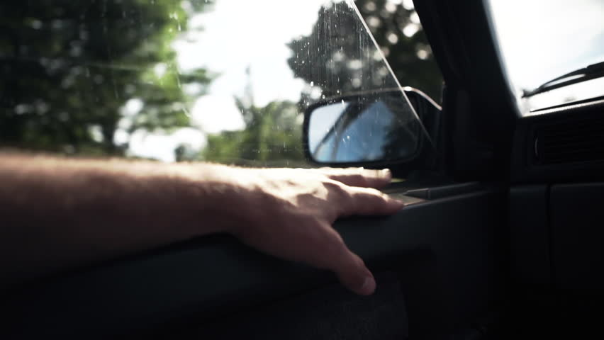 Male Hand Tapping Inside Car Lens Flare Road Trip #1016367436