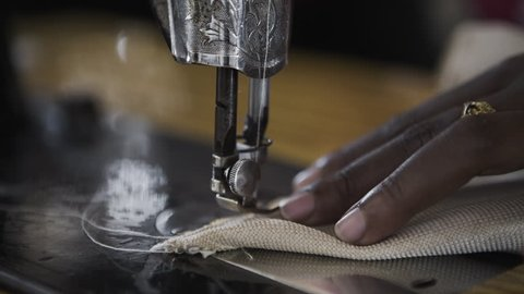 African Women Sewing with Mechanical Machine