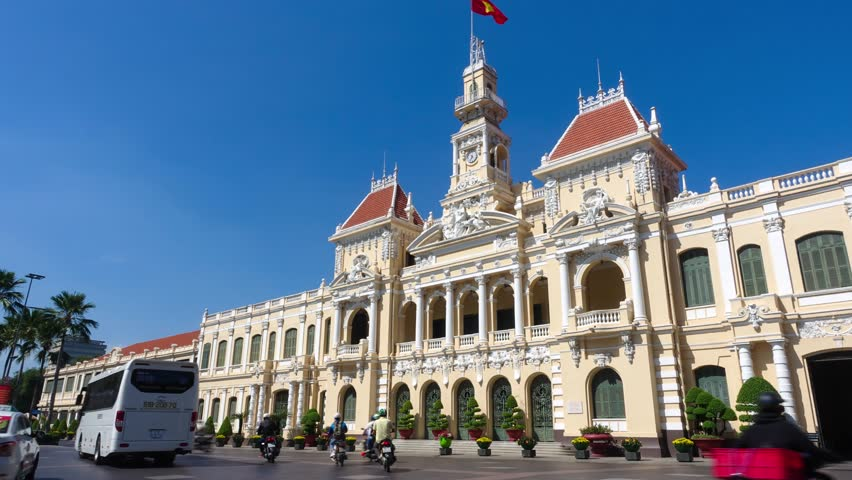 Ho Chi Minh city, Vietnam. Timelapse landscape skyline of the Ho Chi Minh City Hall or Ho Chi Minh City People's Committee in a sunny day. Royalty high-quality free stock footage time lapse beautiful